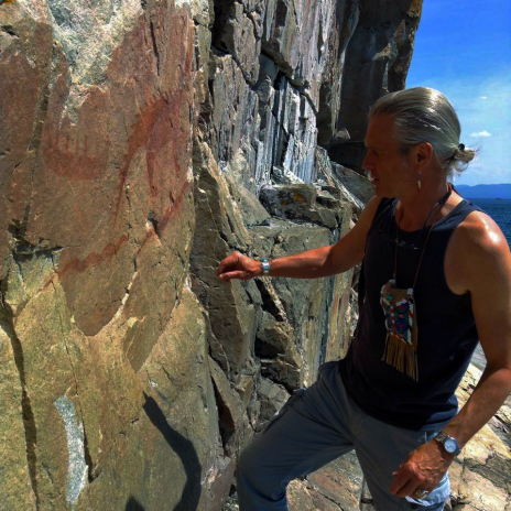 Native Woodland art jeweler Zhaawano offering tobacco to his ancestors at the Anishinaabe pictographs at Agawa Rock, Ontario, July 2015
