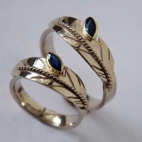 Sound Of Flight white gold eagle feather wedding rings set with marquise-cut sapphires