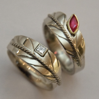 Sky dreamers white gold and red ruby wedding rings
